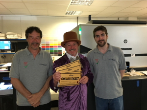 Bob Short (centre), md of the Imaging Centre in Willy Wonka mode with some of the Gold tickets for Retas winners to spend at PG Live.