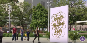 Families surprised their mums with a handwritten message in a giant Hallmark Mother's Day card in Los Angeles.