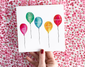 The website covers JanieWilson's cards and candles.
