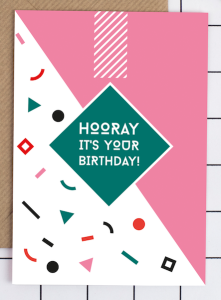 Simple geometrics and slashes of pink on a Kate and the Ink card.