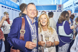 Unit 7's Andrea Pinder enjoys a glass of bubbles with agent Nigel Spensley at the show.