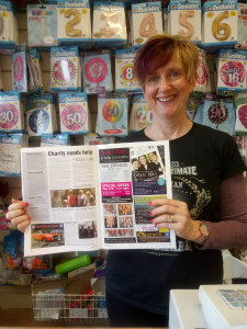 Linda Bygrave of Hallmark in Aylsham with a copy of Just Aylsham.