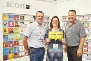 Southbourne Cards' Deborah Tingay spending her Sunshine ticket on the Icon stand with Alan Holmes (left) and agent Sean Edwards.