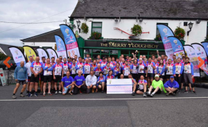 The 65 Light Fund cyclists at the end of their 325-mile route last Friday.