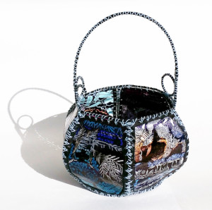 A basket made by Meri inspired by the greeting card basket, but made from reclaimed plastic packaging.