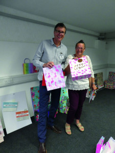 House of Cards' Nigel Williamson with Kim Foster (Hawley Garden Centre) considering some of the giftwrappings entries at the recent Henries' judging.
