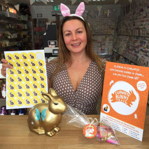 Julia Keeling with the Bunny Trail leaflet and stickers.