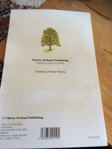 The back of the card stamped with the old Cherry Orchard logo.