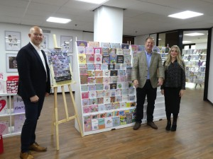 Above: IG Design Group UK's (left-right)David Jackson, channel controller of everyday cards; Adrian Coates, commercial director and Laura Norgrove, design manager of everyday cards in front of a mock up Aldi fixture.