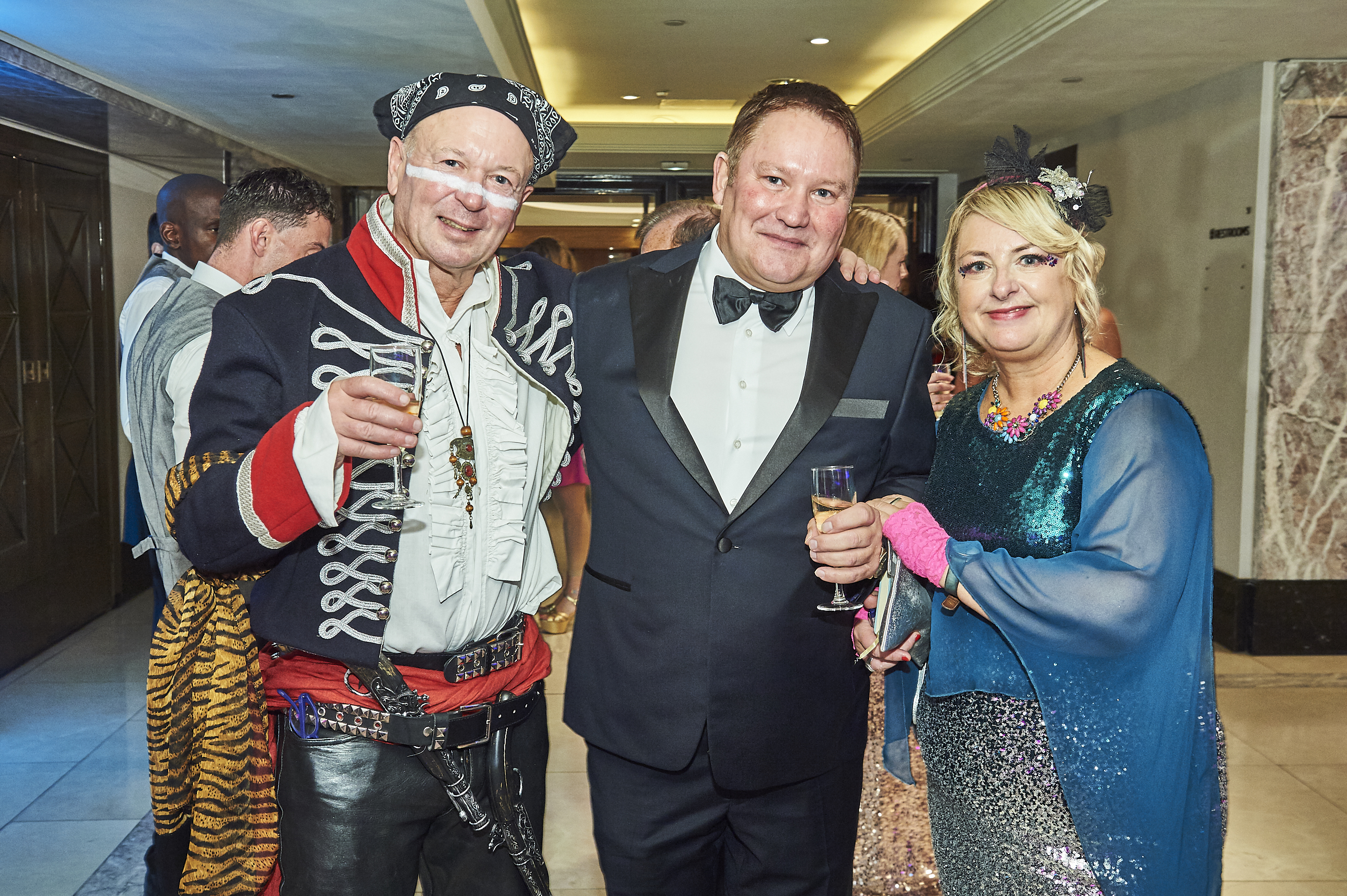 Above: Card Factory's creative director and major shareholder, Stuart Middleton (centre) with PG's Jakki Brown and Warren Lomax who was 'adamant' about being dressed for the theme.