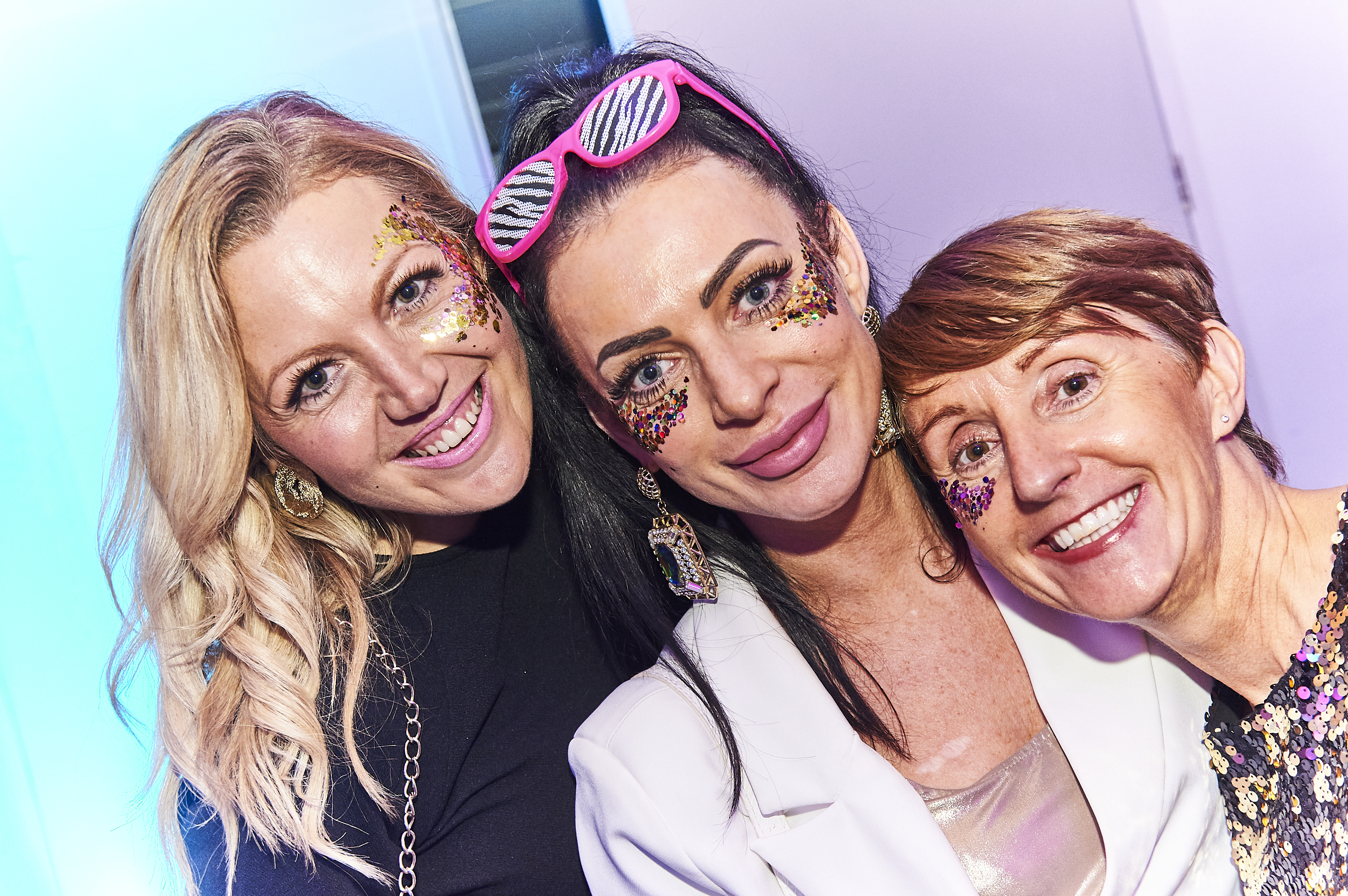 Above: The Five Dollar Shake Glitter Station was a very popular addition to the event. Members of the glitterati included Card Factory's Zoe Procter (centre) with UKG's Rachel Wood (left) and Ceri Stirland.