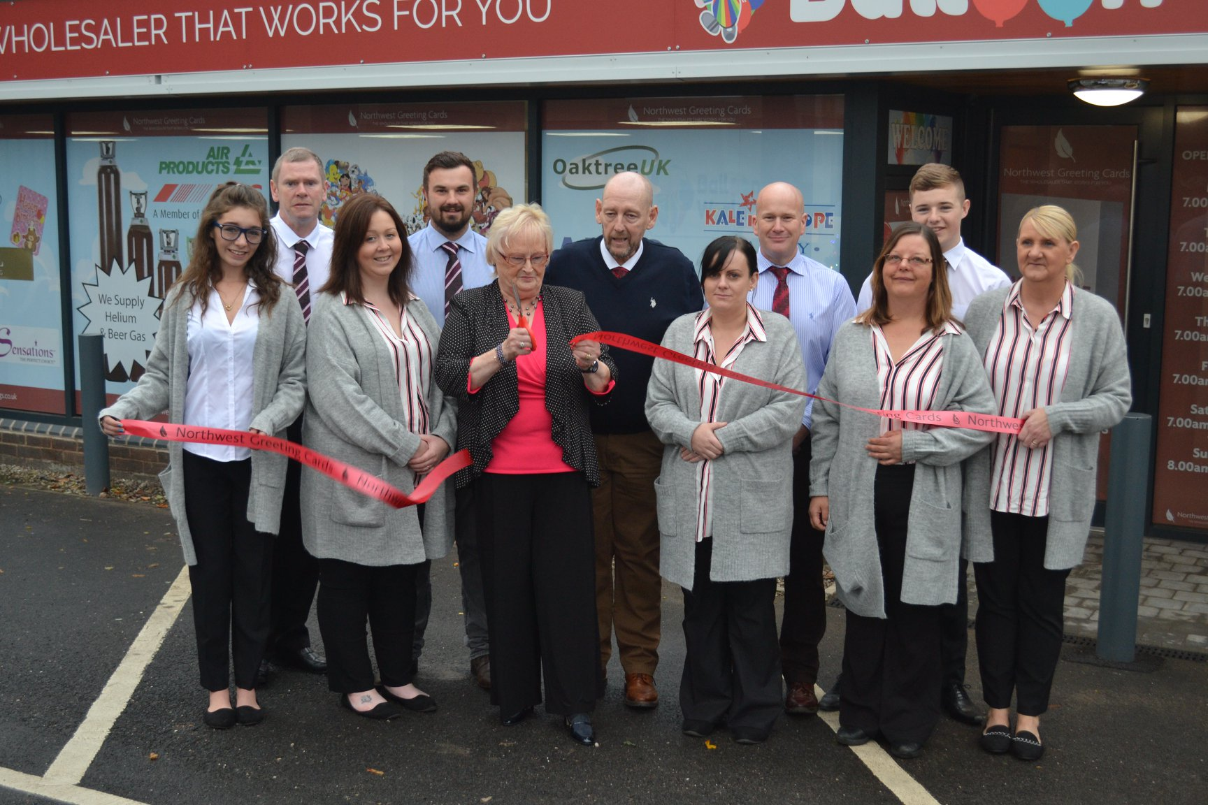 Above: Richard's mum did the honours and pronounced the new wholesalers open for business.