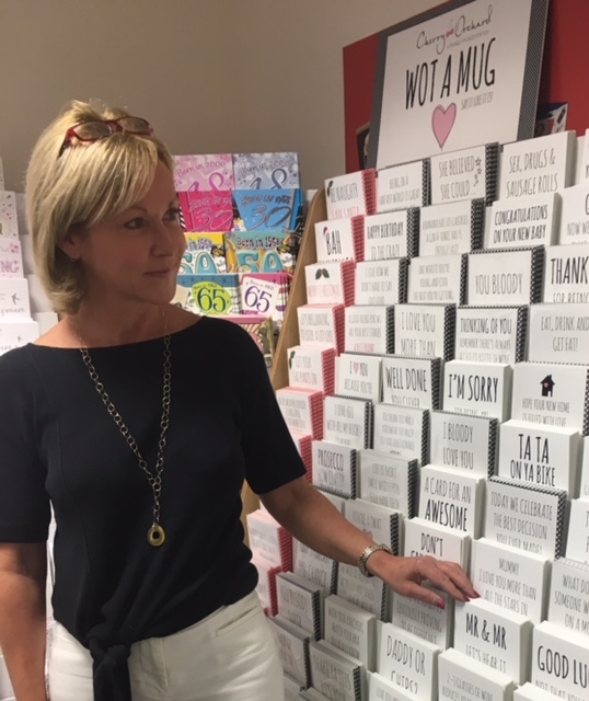 Above: Jackie Collins, md of Cherry Orchard in front of a Wot a Mug card display.