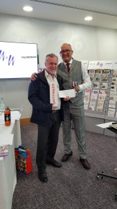 Above: Words 'n' Wishes md Rod Brown (right) withDavid Larmour, its agent who won the company's salesperson of the year for the third year.