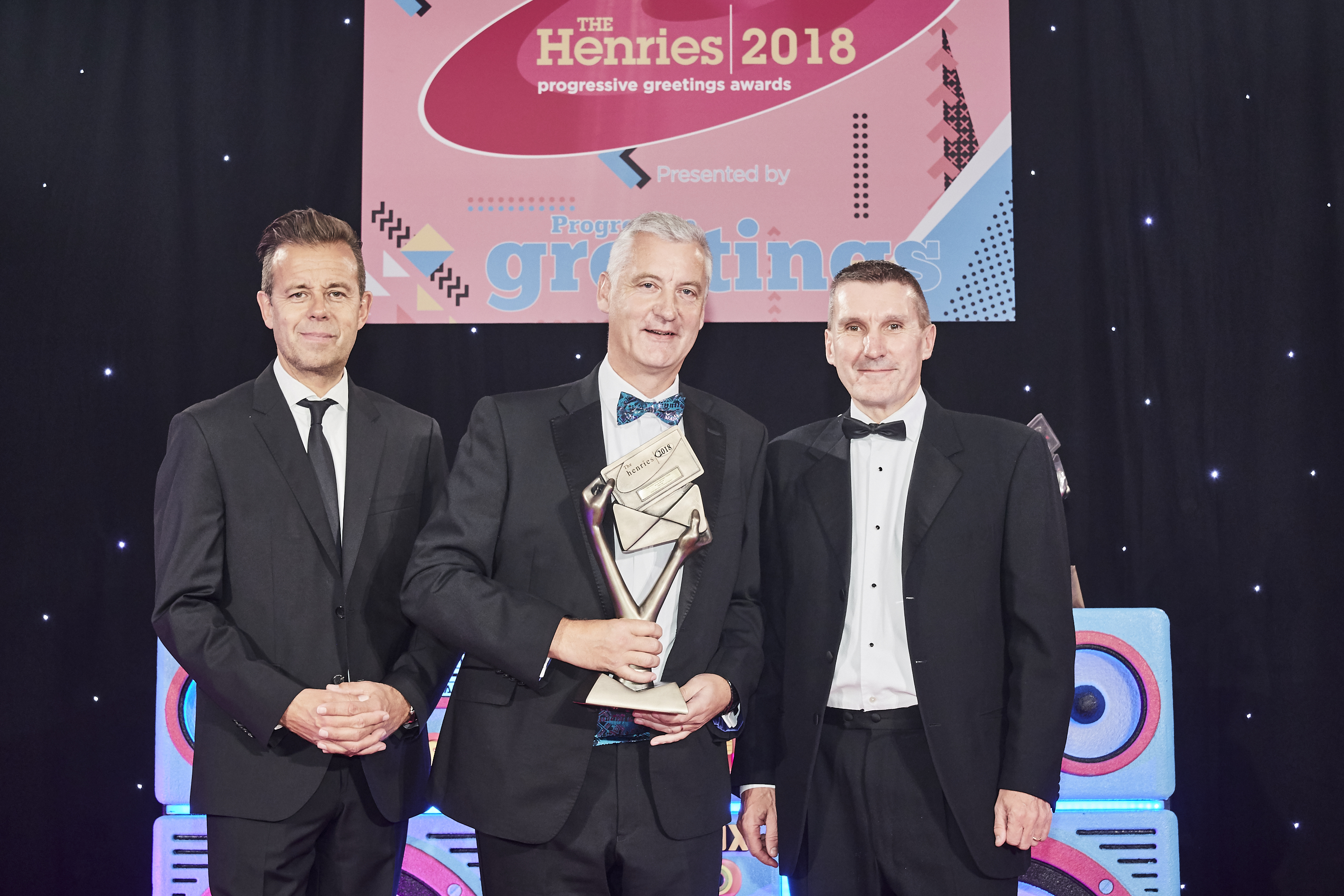 Above: Jarle Tatt, managing director of Noel Tatt (second left) at The Henries 2018 awards collecting the Bronze trophy for Best Service to the Independent Retailer from (right) Richard Campbell of Herbert Walkers, sponsor of this category and Pat Sharp who hosted the event.