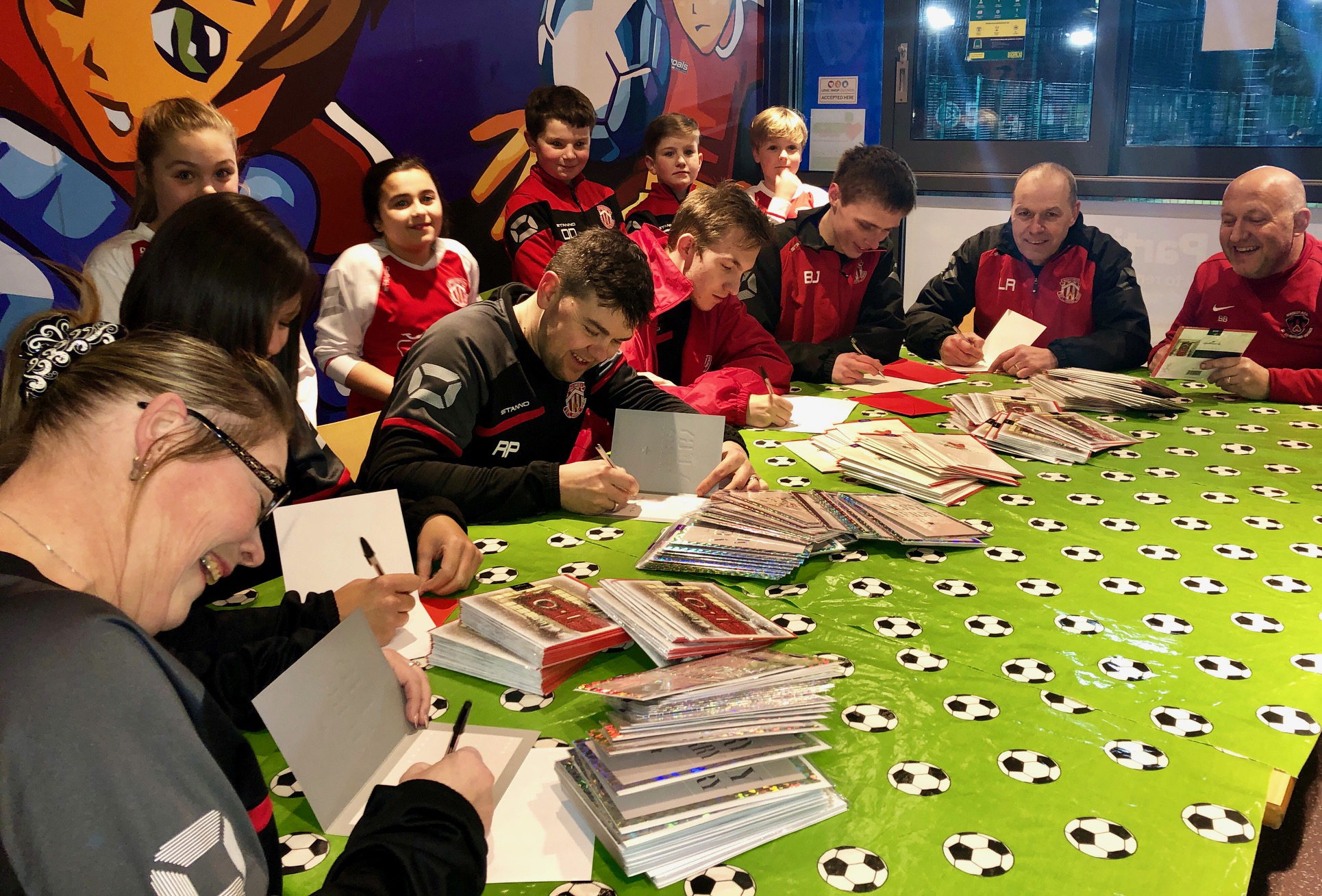 Above: Hallmark teamed up with its local football club, Thackley Juniors, donating 400 Christmas cards so that the football club coaches could say thank you and Merry Christmas to the parents of their players. The team got together with their coaches for a group Christmas card writing session.