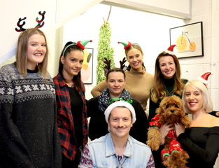 Above: The Tache team (including their four legged staff member!) were suitably attired for their Festive Friday Christmas card writing session.