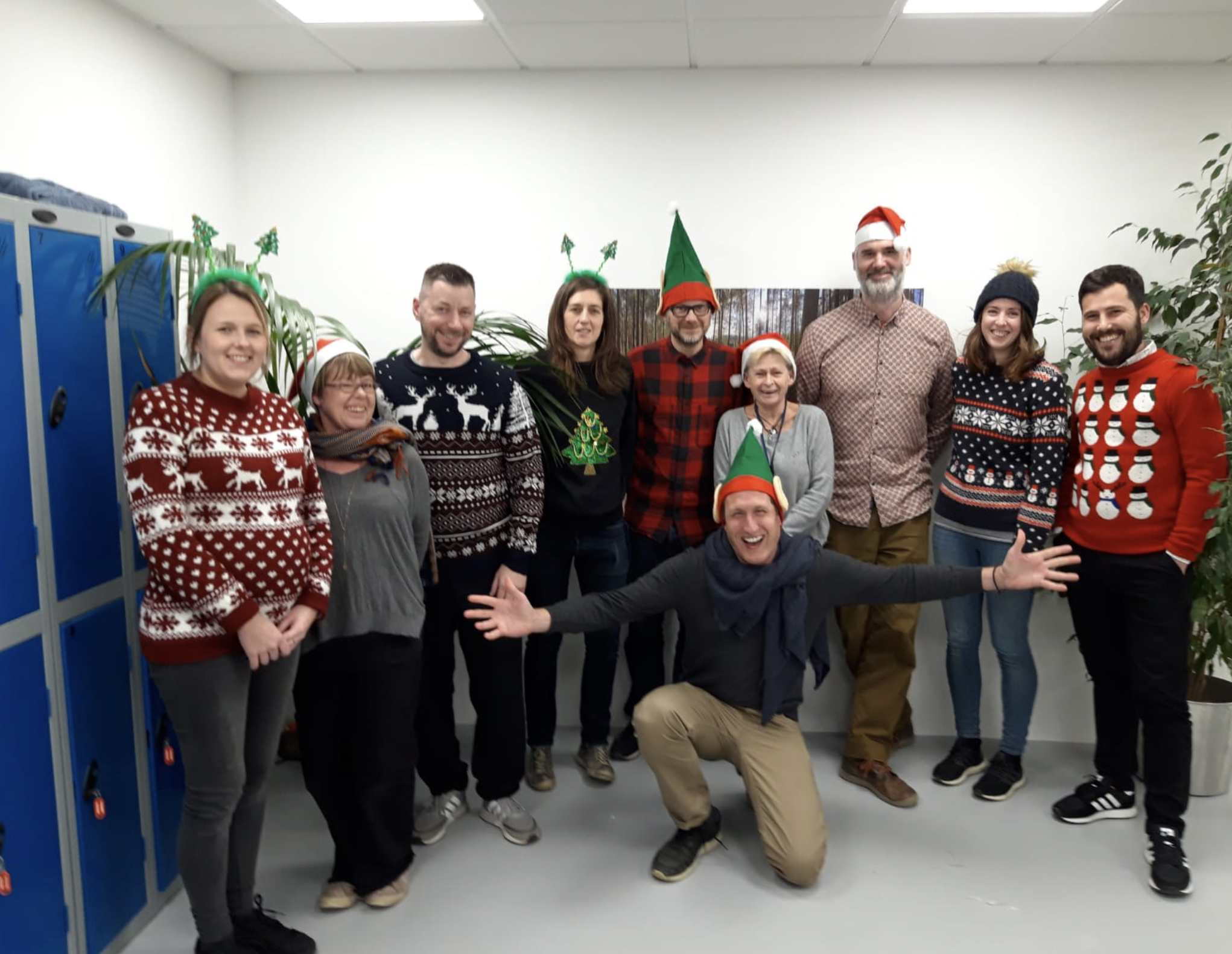 Above: The Blue Eyed Sun team donned their Christmas jumpers as part of the company's Festive Friday action, which saw them write and send over 200 cards.
