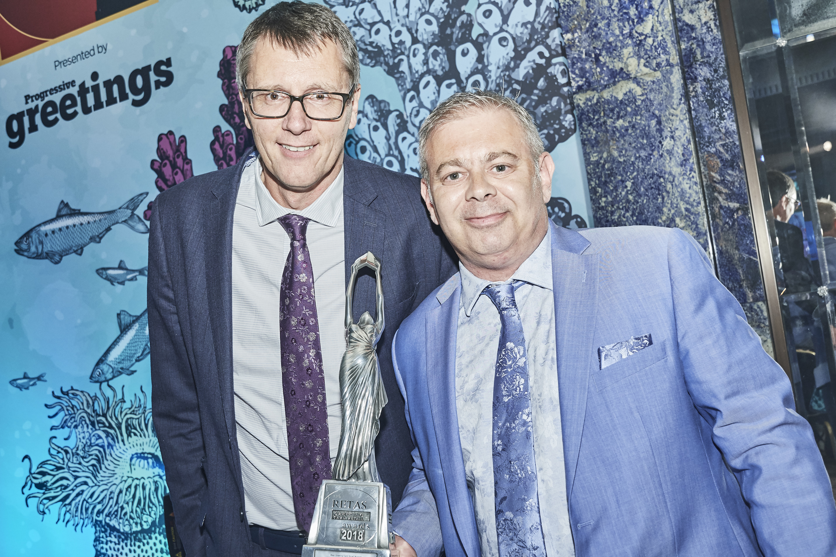 Above: House of Cards' Miles Robinson (right) and Nigel Williamson with their trophy they won at The Retas 2018 in July for Best Greeting Card Small Multiple.