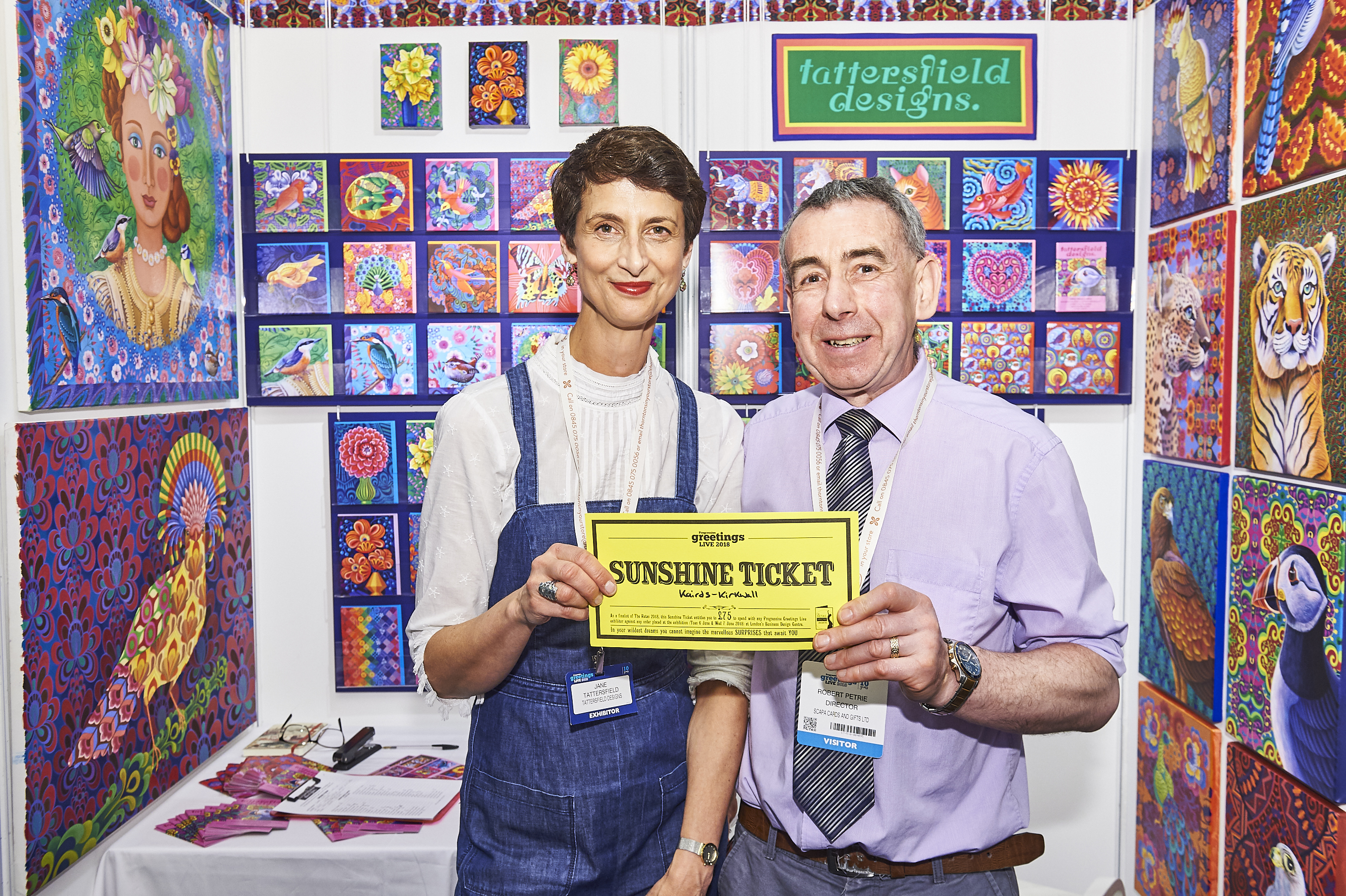 Above: The brandimg for this year's Retas has been created by Jane Tattersfield, founder of Jane Tattersfield Designs. Here she is at PG Live in June with Robert Petrie of Kairds in Orkney who spent his Sunshine Ticket with the publisher.