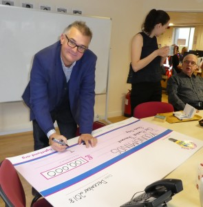 Above: Max Publishing's Ian Hyder, a co-founder of The Light Fund writing out the big cheque for YoungMinds.
