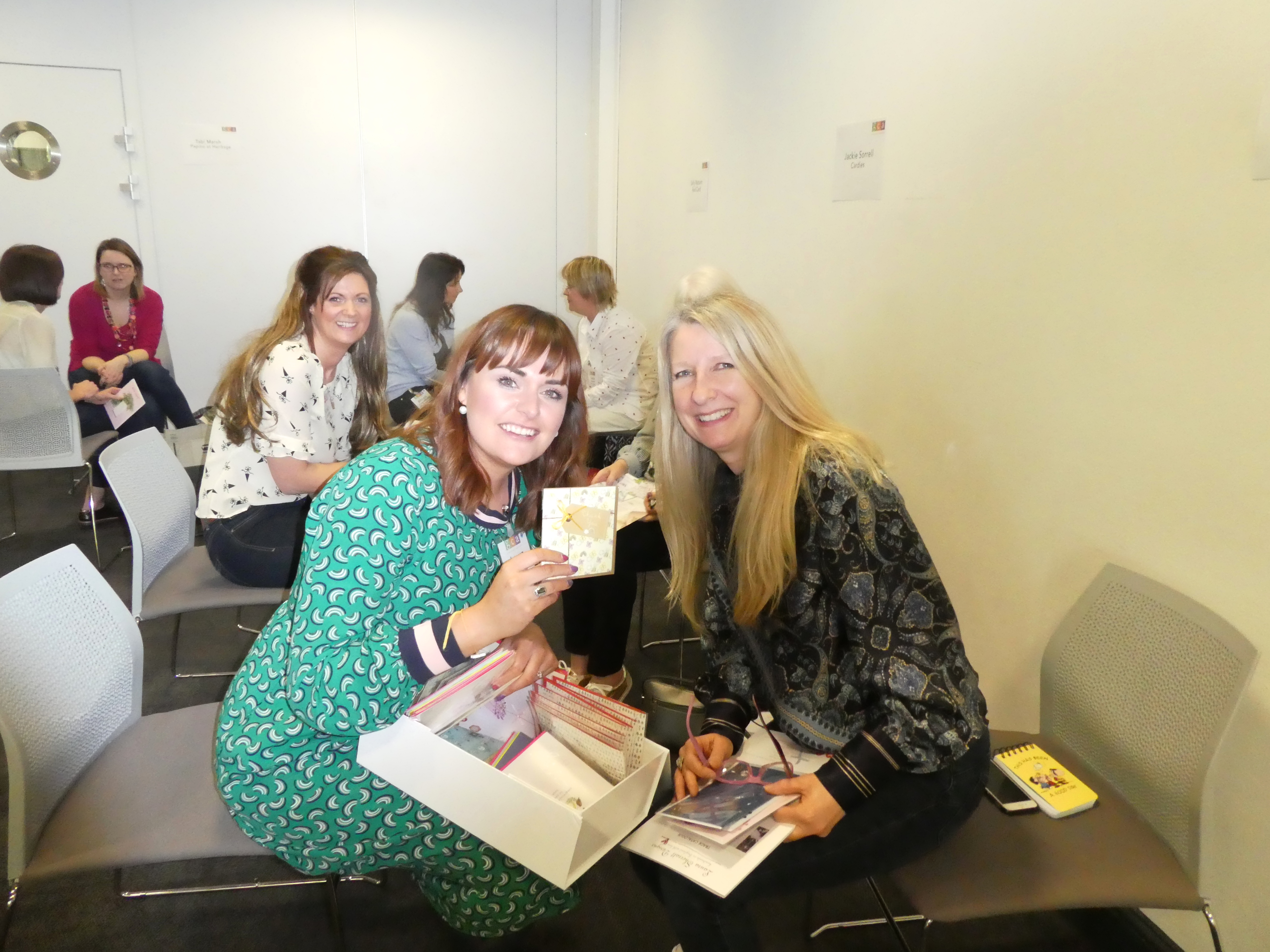 Above: Publisher Laura Sherratt (left) holding the card design that has reached the finals of the US Louie awards, with Cardies' Jo Sorrell, one of the indie 'Dragons'.
