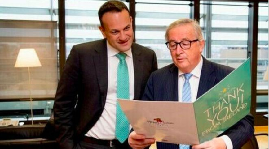 Above: Jean-Claude Juncker reading a Happy Jackson thank you card 'from Ireland', as the Irish prime minister, Leo Varadkar looks on.