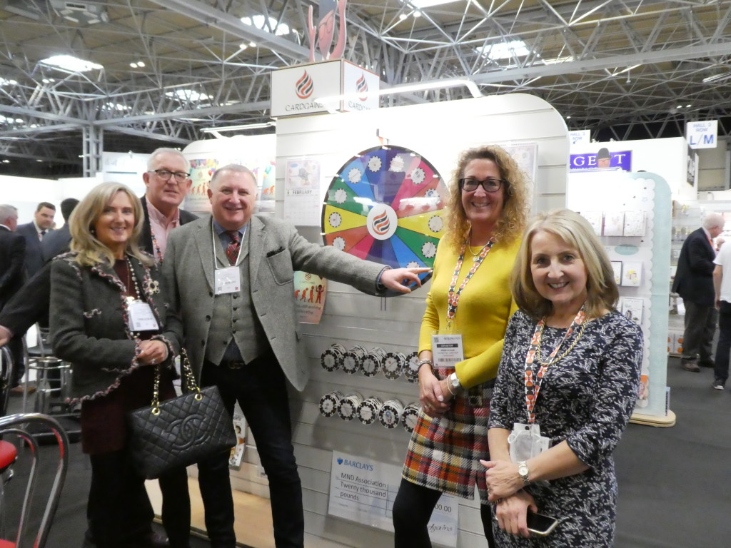 Above: Cardgains retail members First Class Greetings' Jerry (centre) and (far left) Debbie Brown spinning 'the wheel of fortune' on the Cardgains Village with Cardgains' Chris Dyson (second left), Penny Shaw (second right) and Xpressions' Christine Harrison.