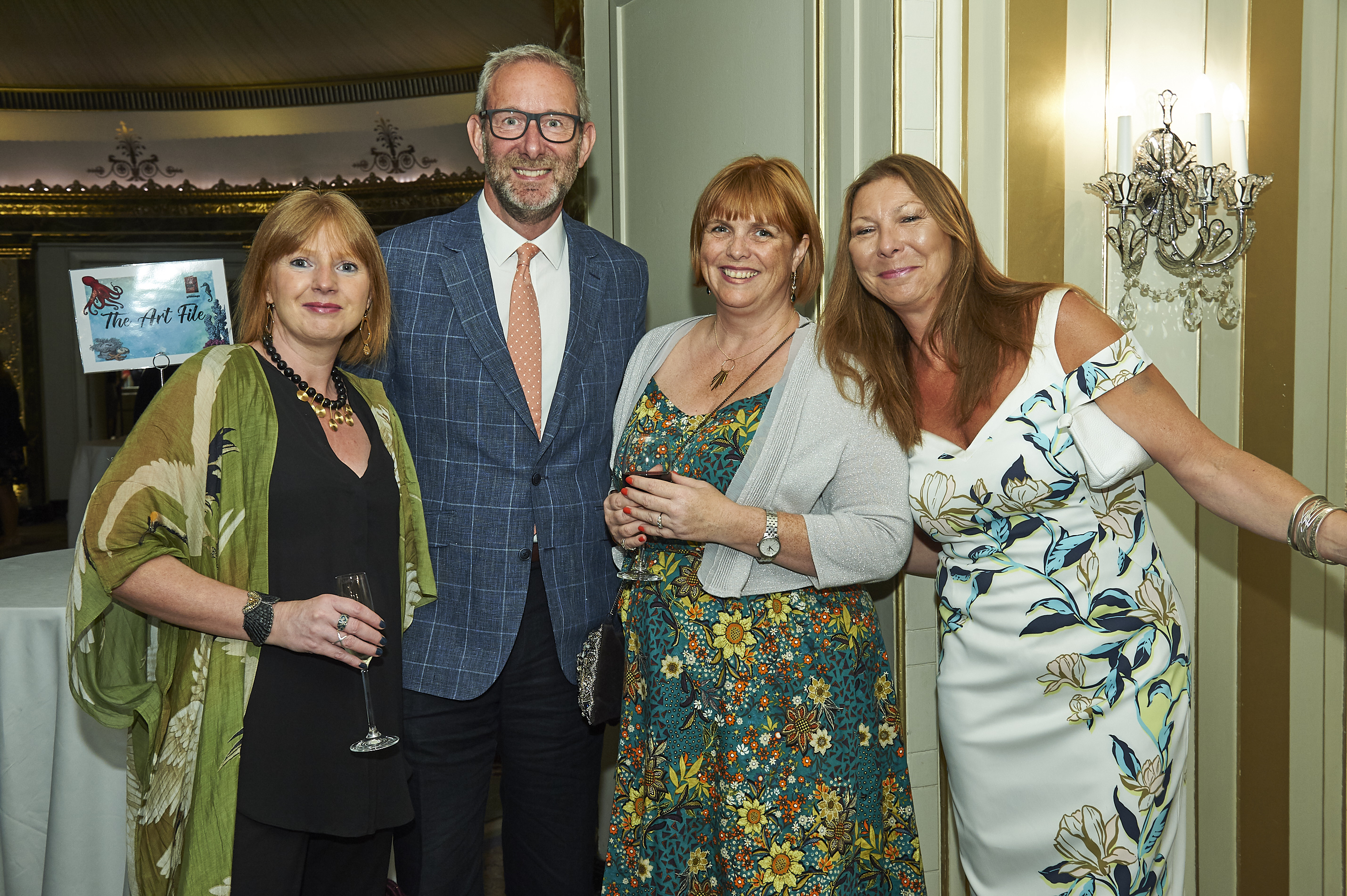 Above: Jo Bannister (right) with Mooch's Sandra O'Connell and Evelyn O'Flaherty, a customer in Ealing, with The Art File's md Ged Mace at last July's Retas awards event.