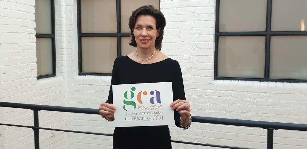 Above: GCA's ceo, Amanda Fergusson holding the new GCA logo.