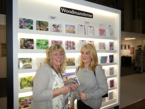 Above: Woodmansterne sales rep Caroline Crawford (left) with retail customer Gillian Harrison of Cards and Candles, Lancaster in front of a display of seal-closed cards on the publisher's stand at the Spring Fair.