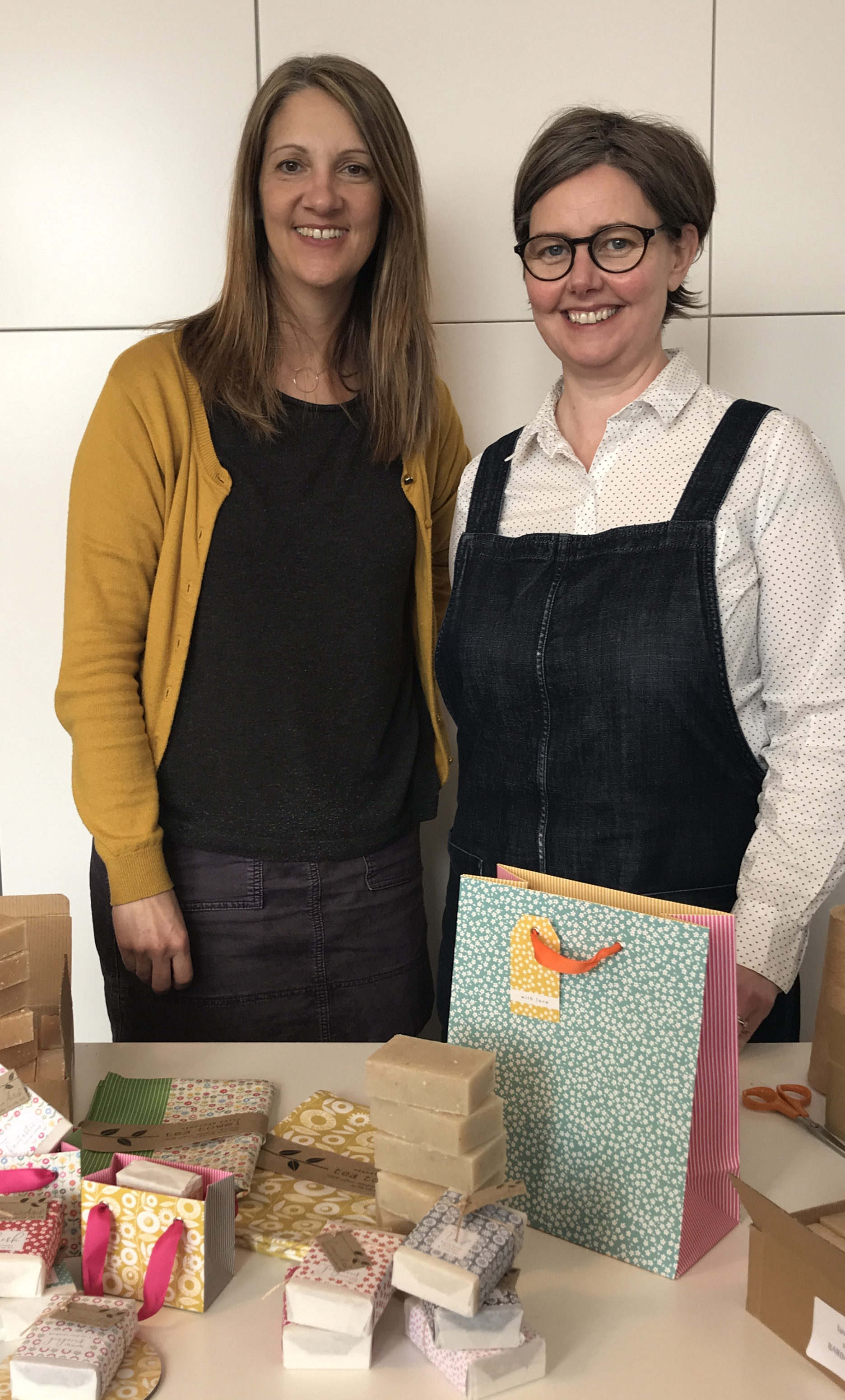 Above: Cinnamon Aitch's co-founders Sara Burford and Sarah Fitzpatrick with some of the new Cherry Blossom gift lines.