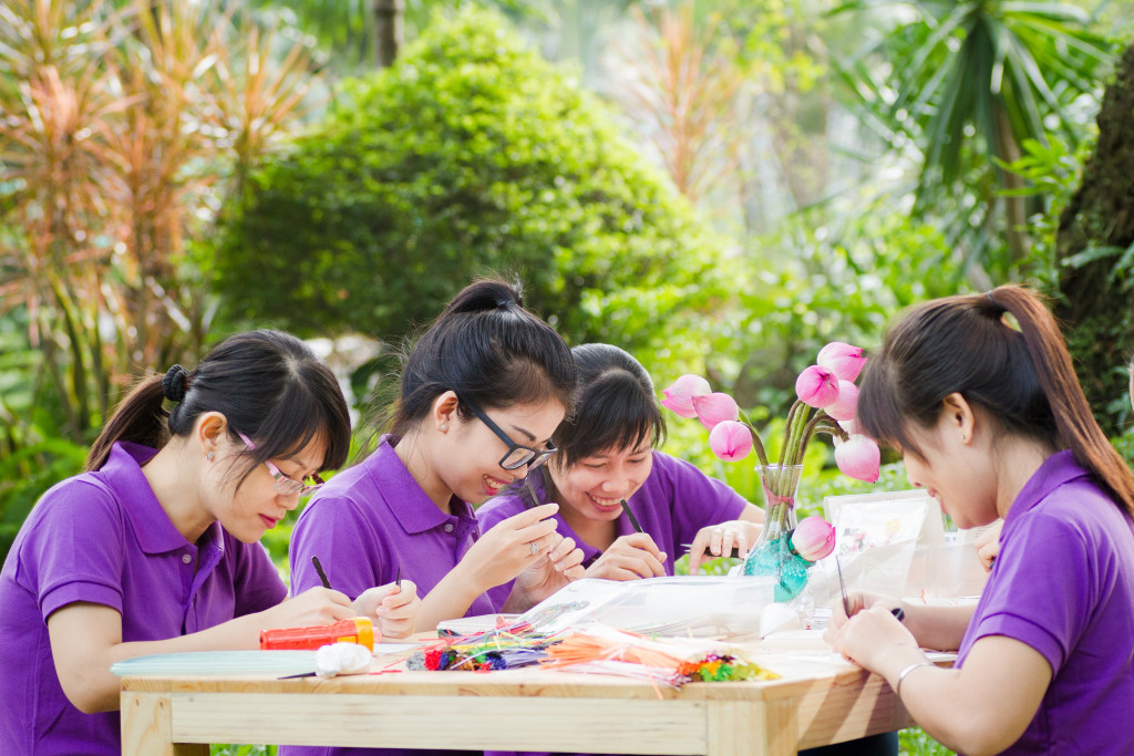 Above: Some of Quilling Card's craftspeople at work in Vietnam.