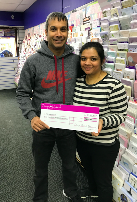 Above: Nimish and Komal of Newsmarket in Rainham with their cheque for £250 as second prize winner.