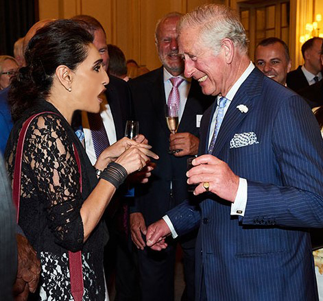 Above: Meera Santoro making Prince Charles chuckle at a Queen's Award event in Buckingham Palace.