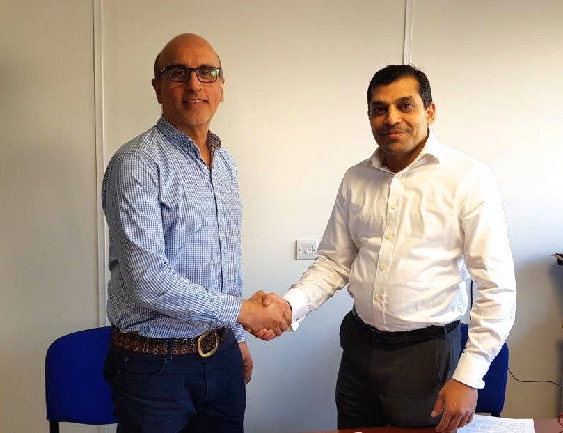 Above: Harry Rai (left) who founded Abbey Cards when he left university passing on the legacy to new owner Sunil Rakholiya.