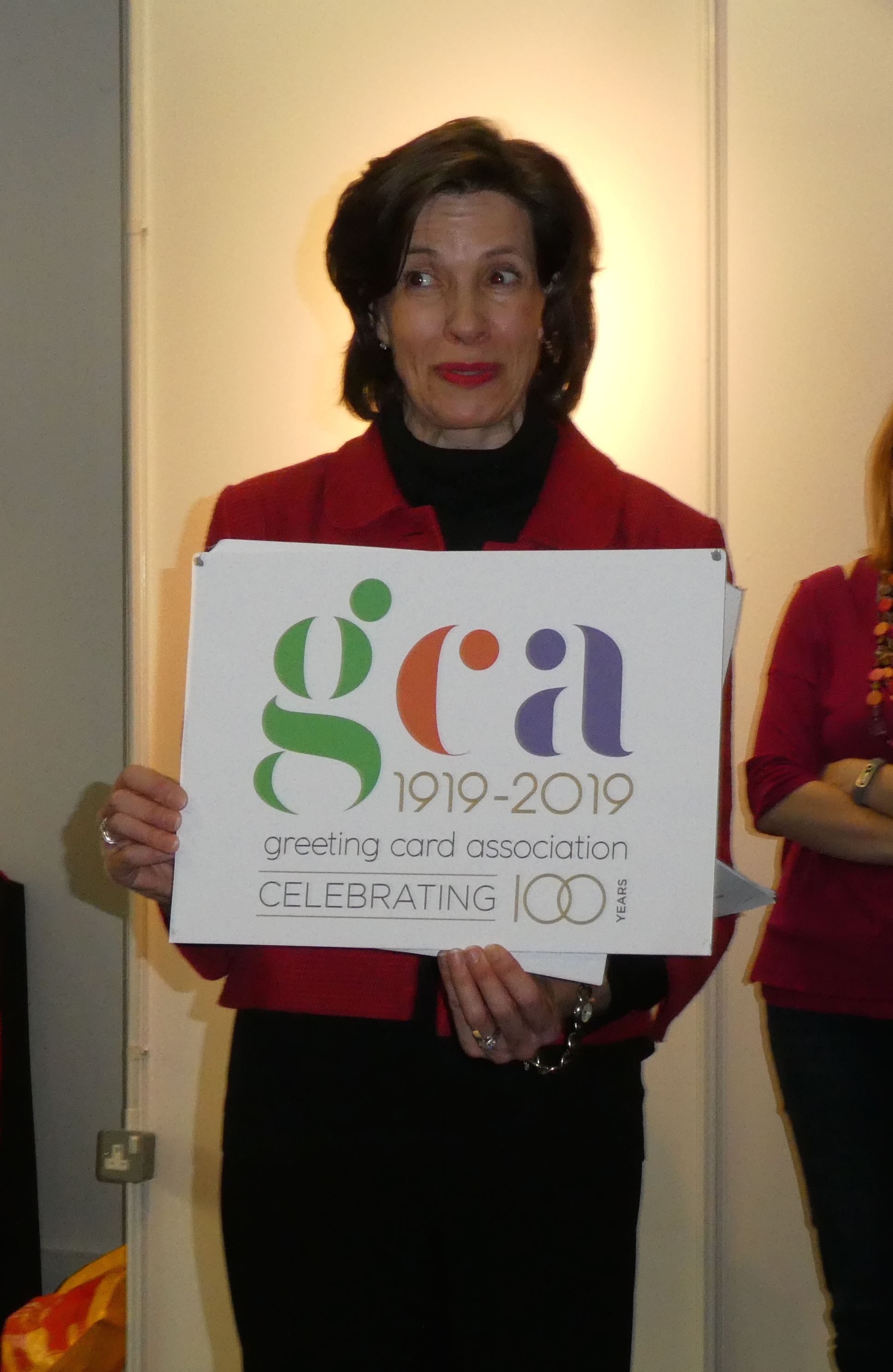 Above: Amanda Fergusson with the new GCA 100thanniversary logo which is to be used extensively this year.