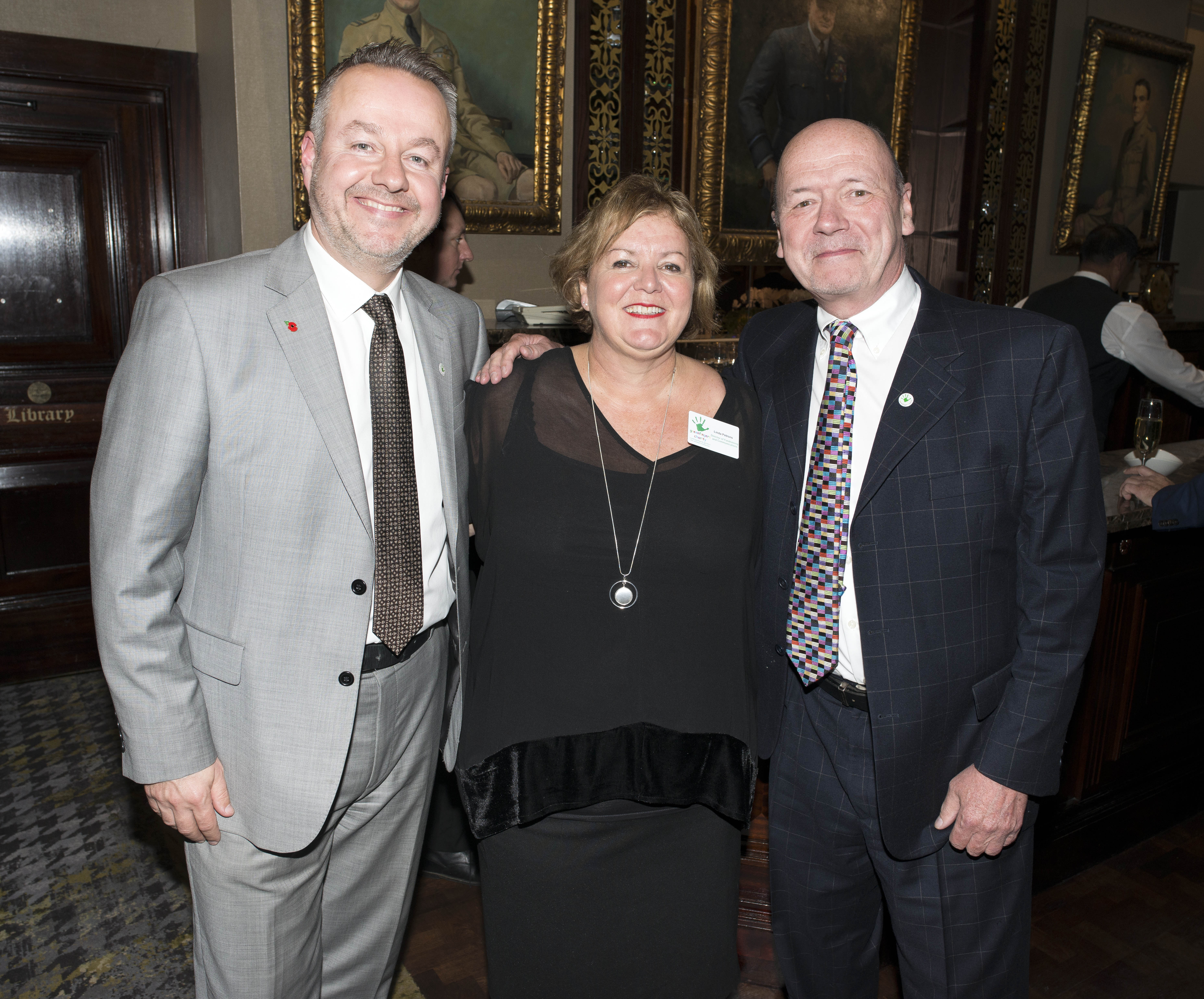 Above: GBCC's Chris Wilcox (right) with colleague Michael McGunnigle and Linda Petrons of Greenfingers, one of the charities with which the publisher works.