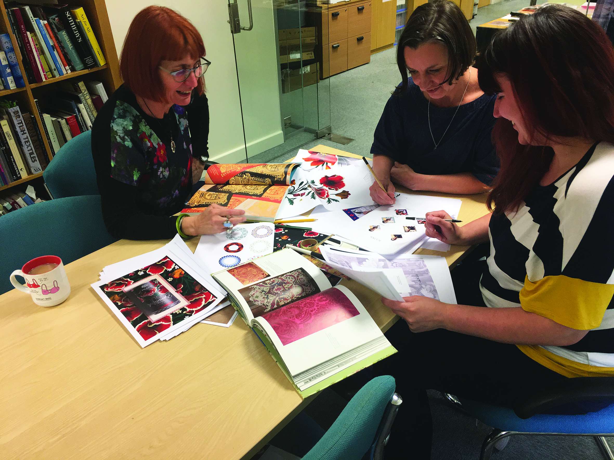 Above: (left-right) Paper Rose's Joanne Eccles, Philippa Phipps and Reggie Pugh working on the ticket design.