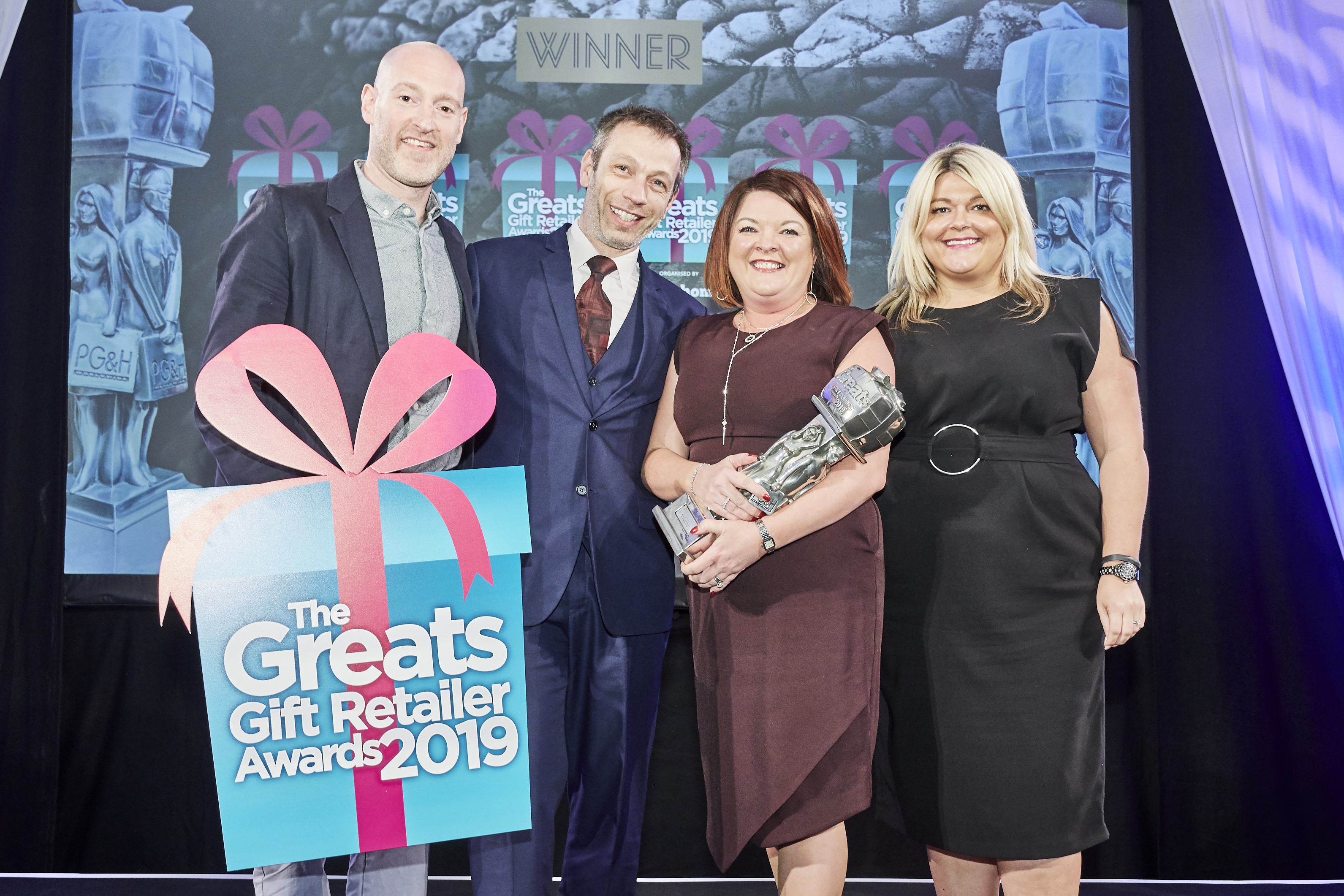 Above: Rachel and Paul Roberts collecting their Greats trophy as Mooch won the Independent Gift Retailer of the Year – Best Newcomer Midlands, North and Scotland.