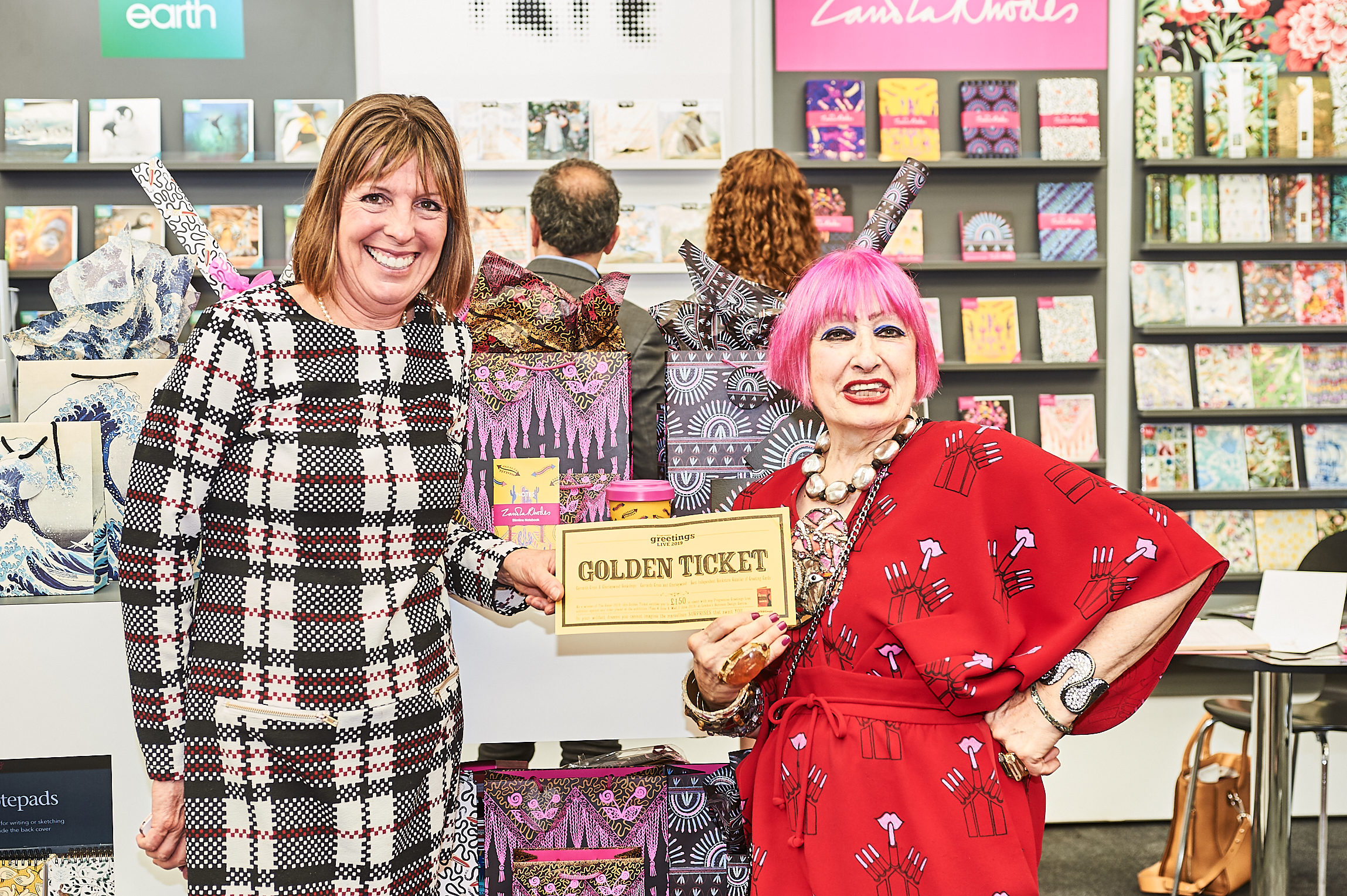 Above: Sheryl Shurville of Chiltern Bookshops (left) was delighted to spend her Golden Ticket on the M&G stand on the Zandra Rhodes collection.