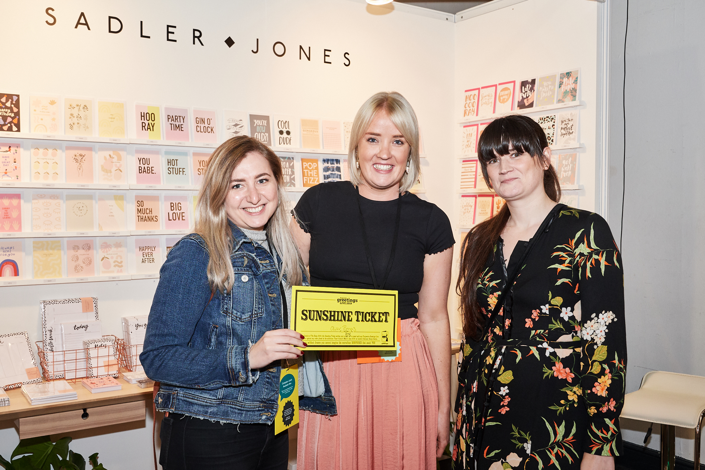 Above: Sadler Jones' Cath Jones (centre) was delighted when Natalia Kostereska (left) and Siobhan Watkins bounced onto the stand and produced their Sunshine Ticket at the show!