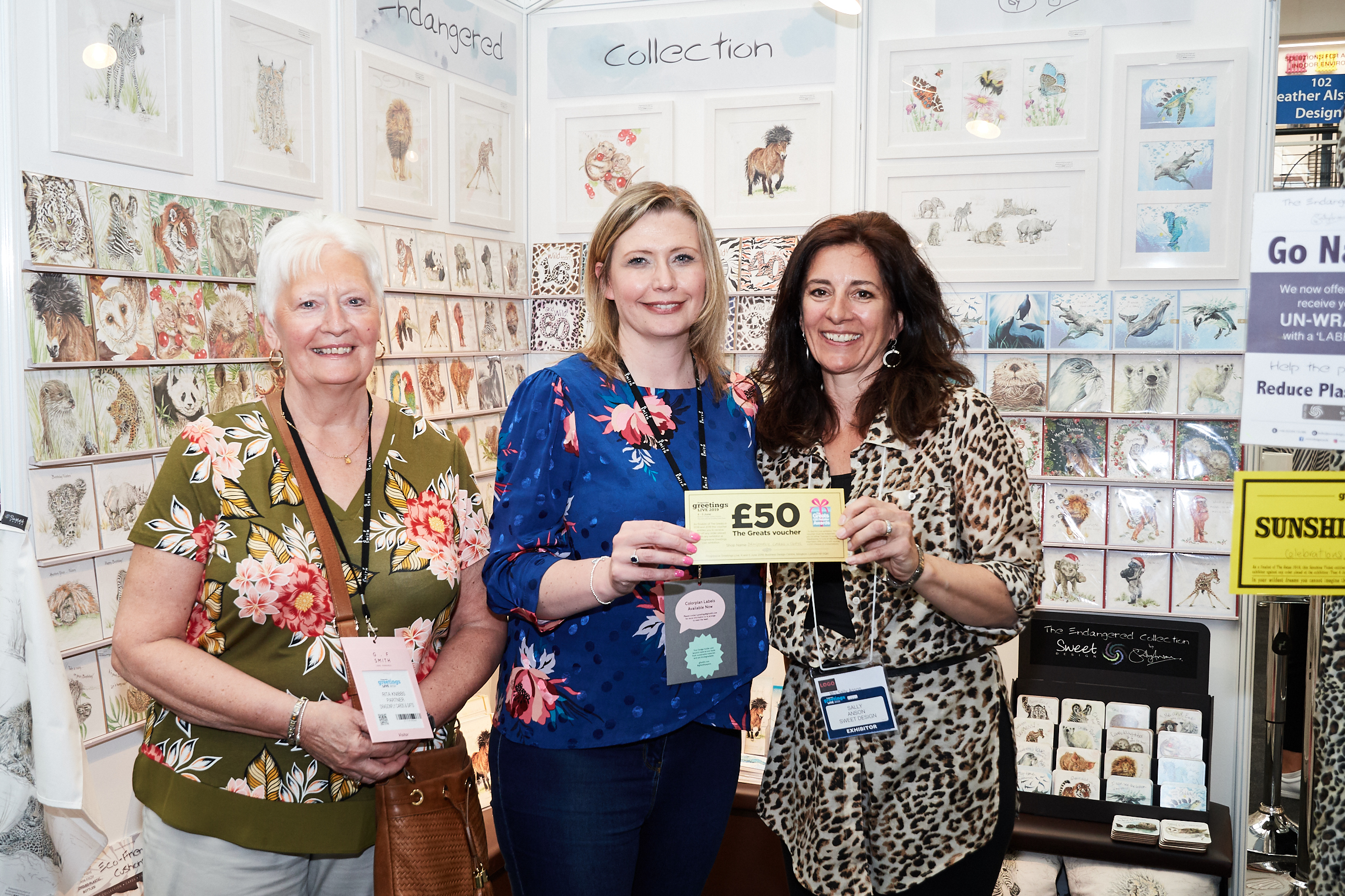 Above: Dragonfly Cards and Gifts' Rachael Barnes (right) and Rita Knibbs (left) with Sally Anson, founder of Sweet Design.