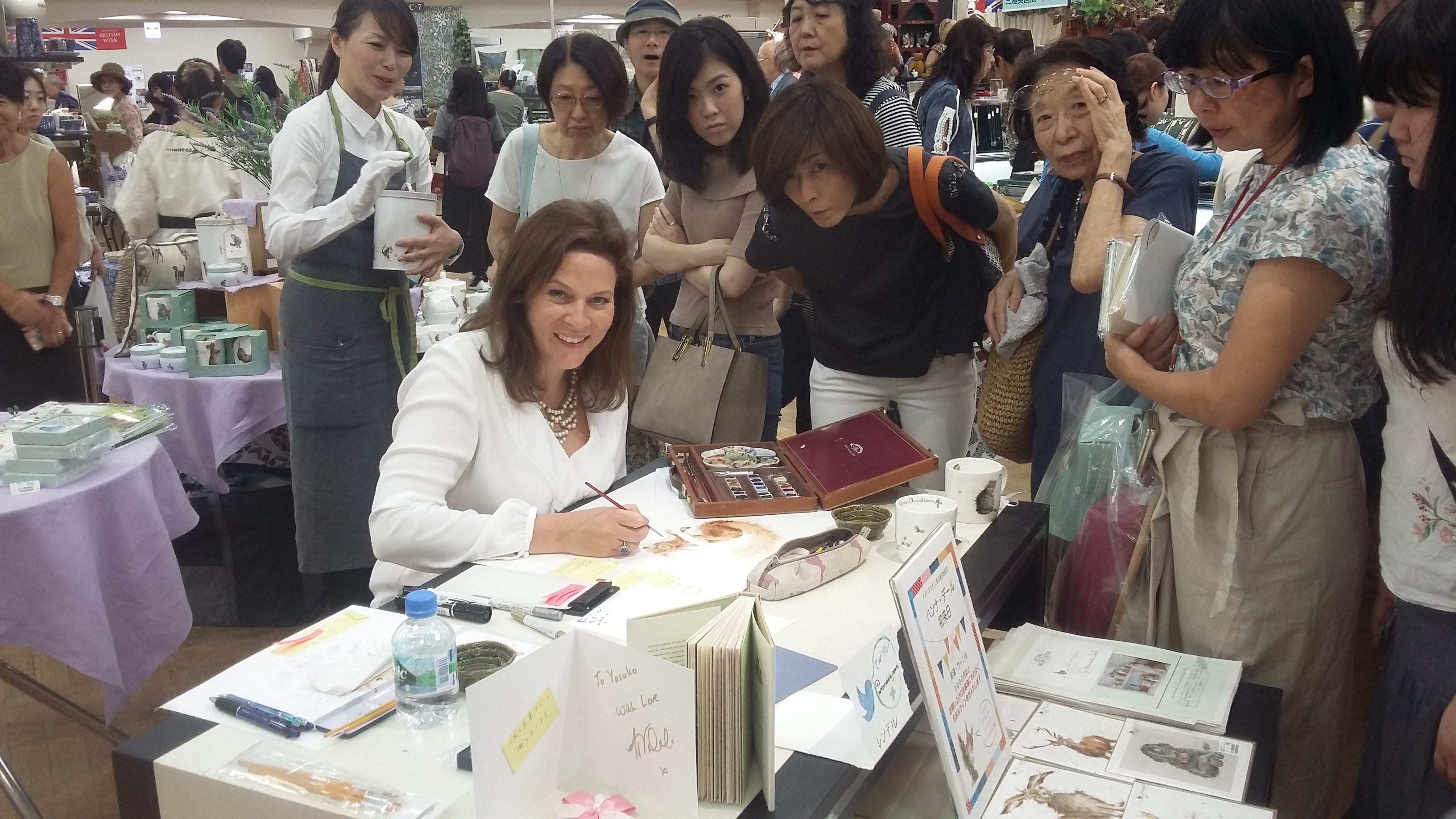 Above: Hannah painting in a Japanese department store as part of its British Week activities.