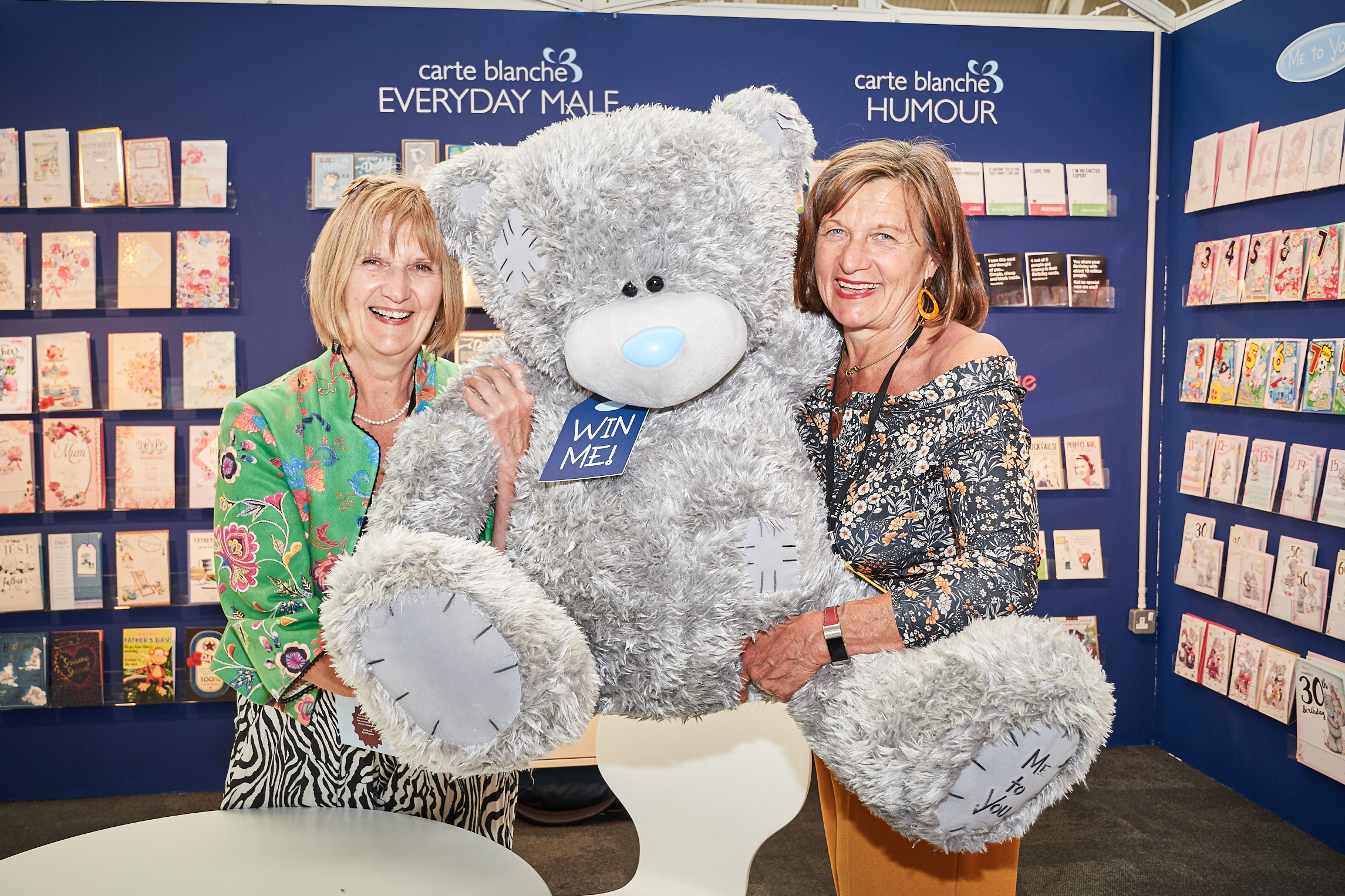 Above: South West indie, (left) Maggie Wynn, owner of Just Cards in Honiton and mangeress Angie Prior were 'beary' happy to have won a huge Me to You bear in Carte Blanche's first day prize drawer at PG Live. Eileen Le Net from Albion Books, Hove won the giant Tatty Teddy in the second day draw.