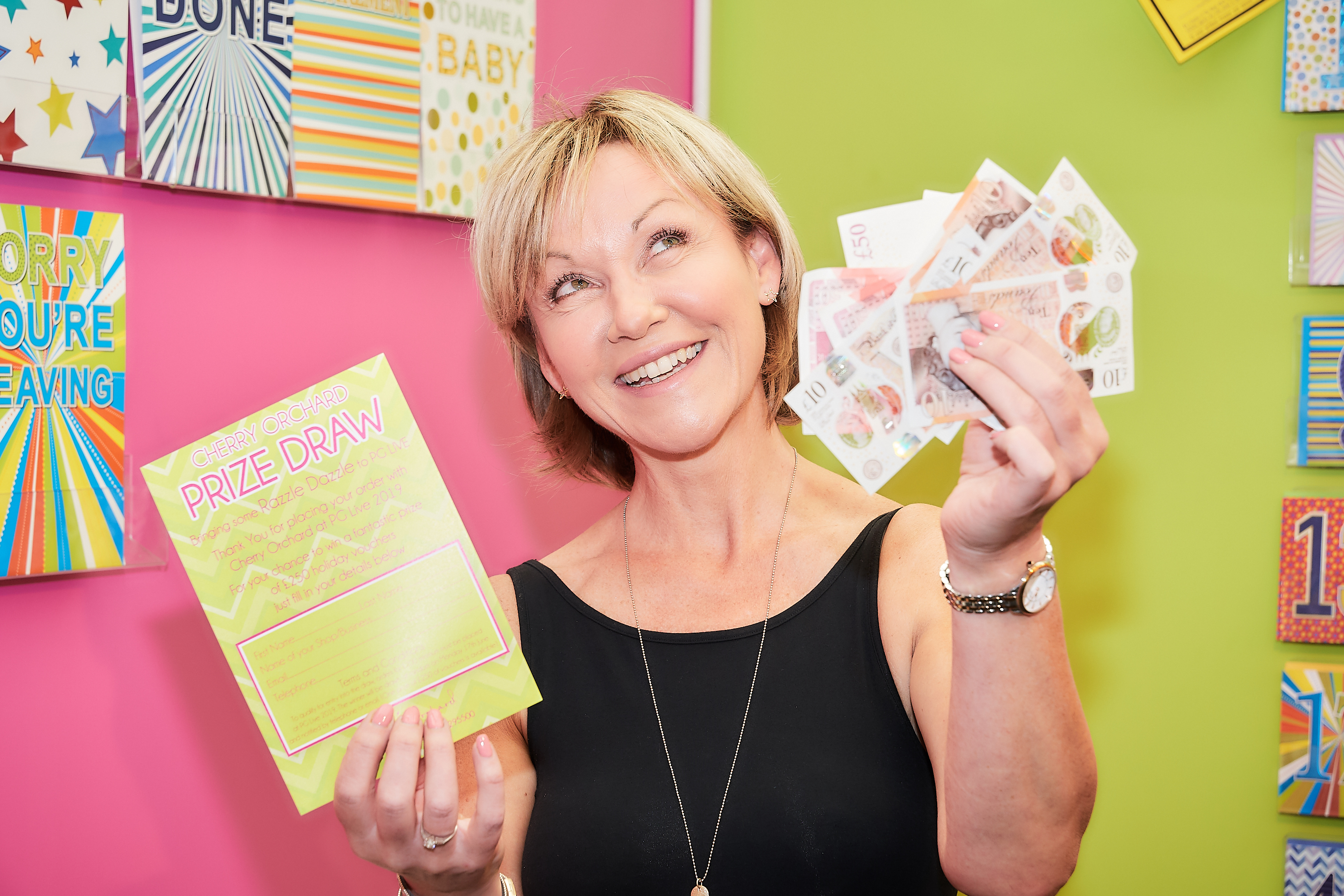 Above: Jackie Collins, managing director of Cherry Orchard is ready with 'the readies'. To add some extra razzle dazzle to the launch of its Razzle Dazzle range, there was a prize draw at the show with £250 of holiday vouchers up for grabs.