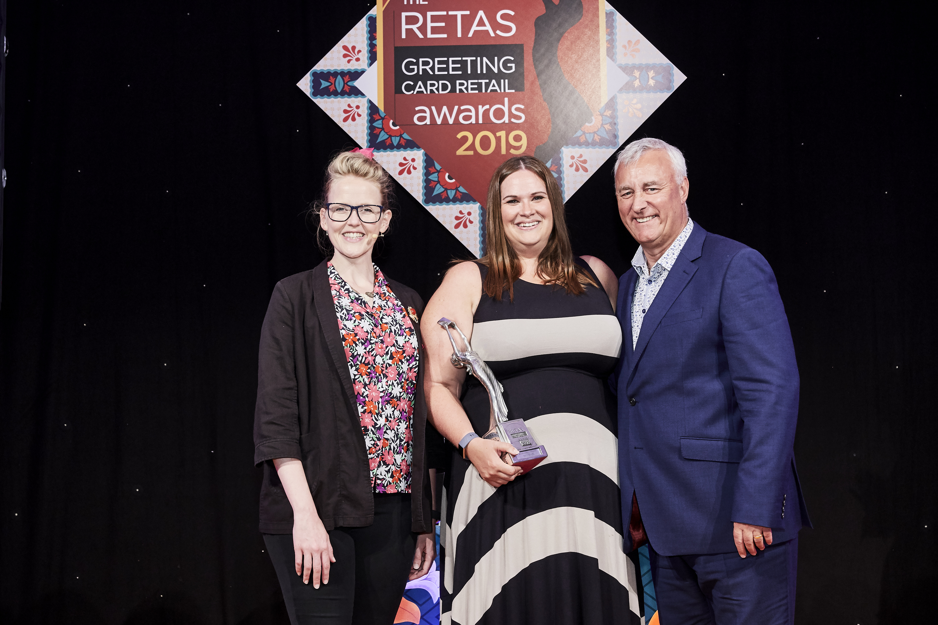 Above: Carly Pearson, senior buyer for Sainsbury's, was over the moon to accept her Retas award from Simon Boyd, operations director and co-owner of category sponsor, Progressive Greetings Live.