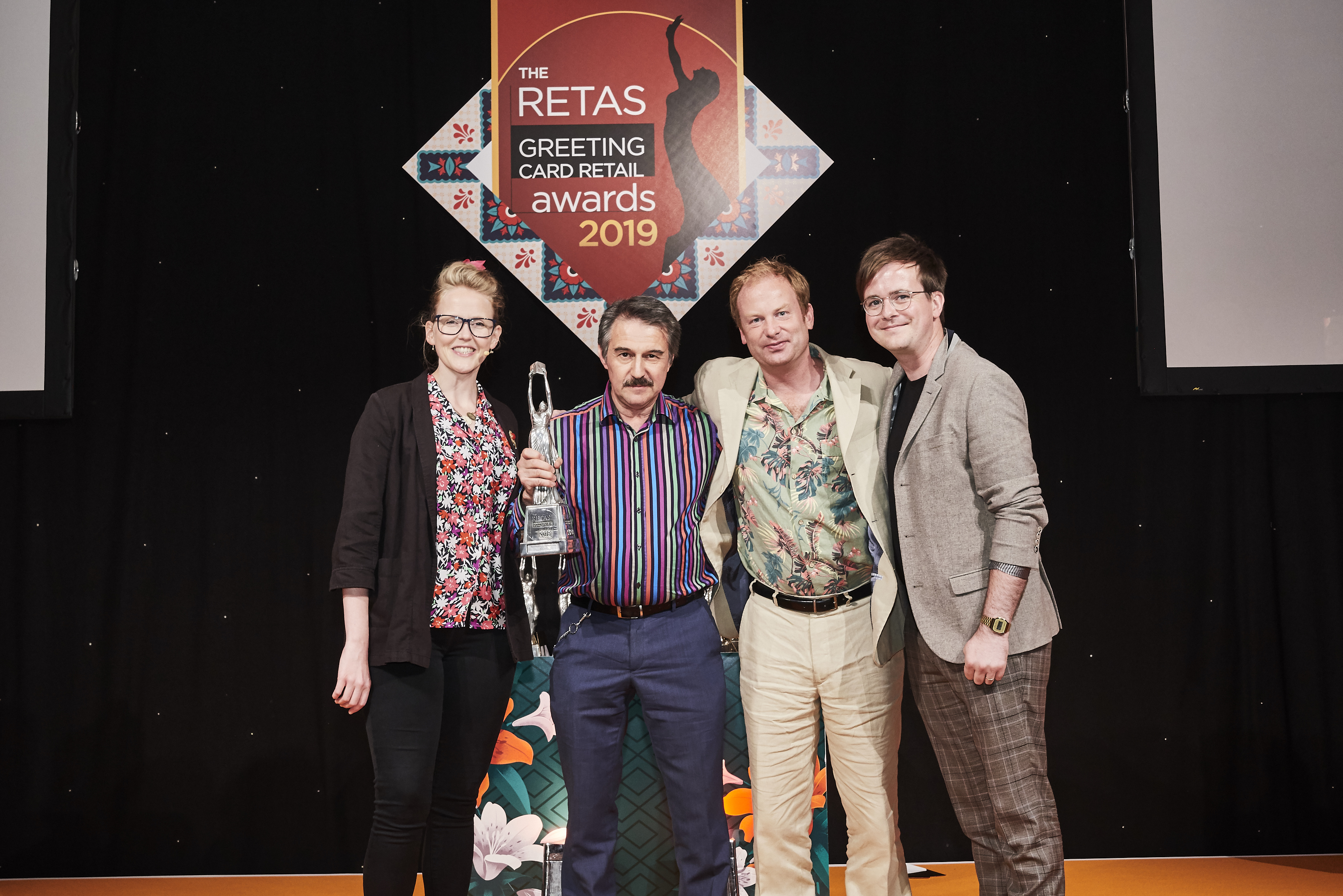 Above: (second left-right) Medici Gallery's Tim Reynolds and Charlie Wheatley receive the trophy from Mark Callaby, managing director for Ohh Deer, category sponsor.