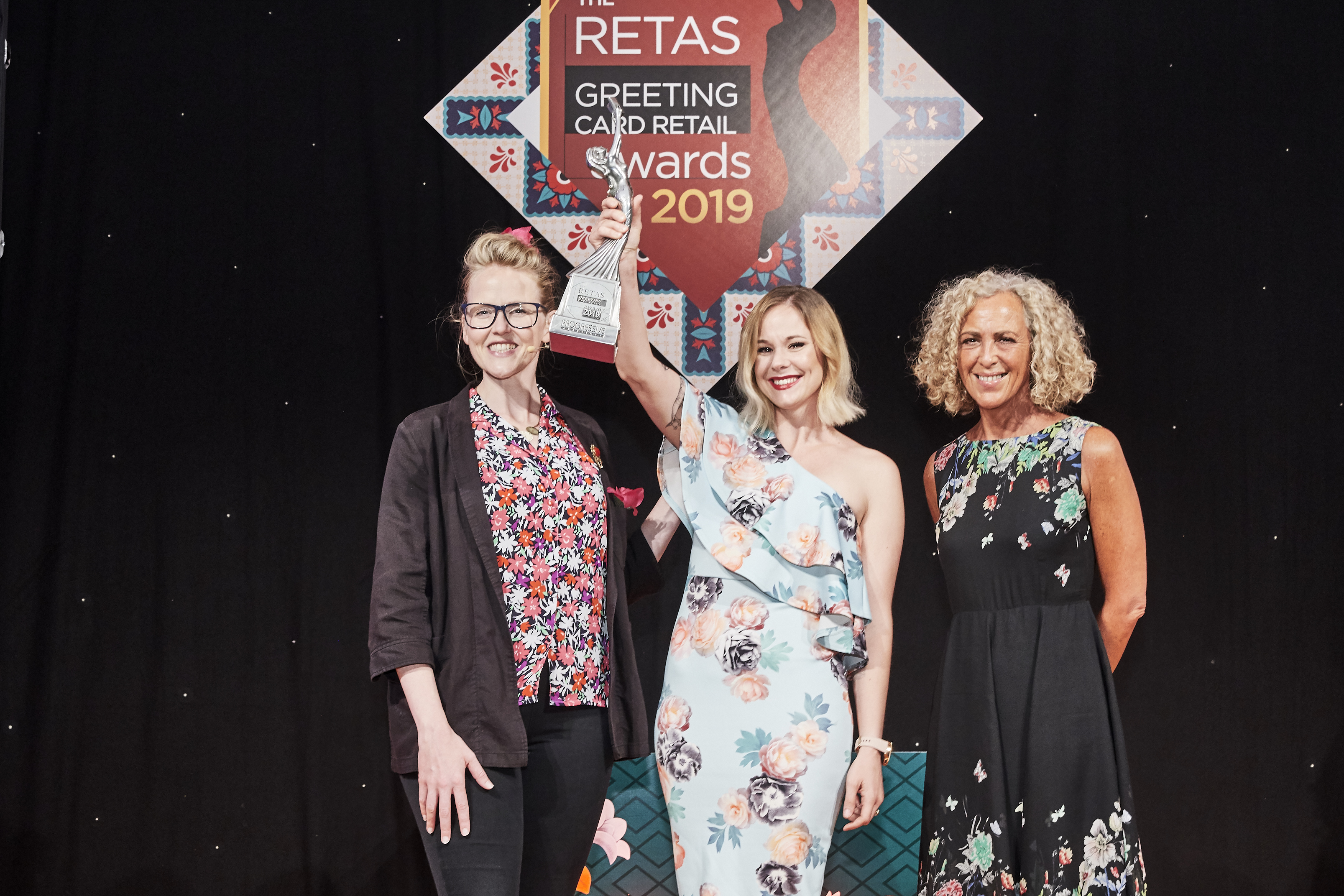 Above: Angie Goosen, category manager – paper products for Blue Diamond Group, wins The Retas double accolade and accepted the Greeting Card Retailer of the Year award from Karen Mace, joint owner of category sponsor, The Art File.