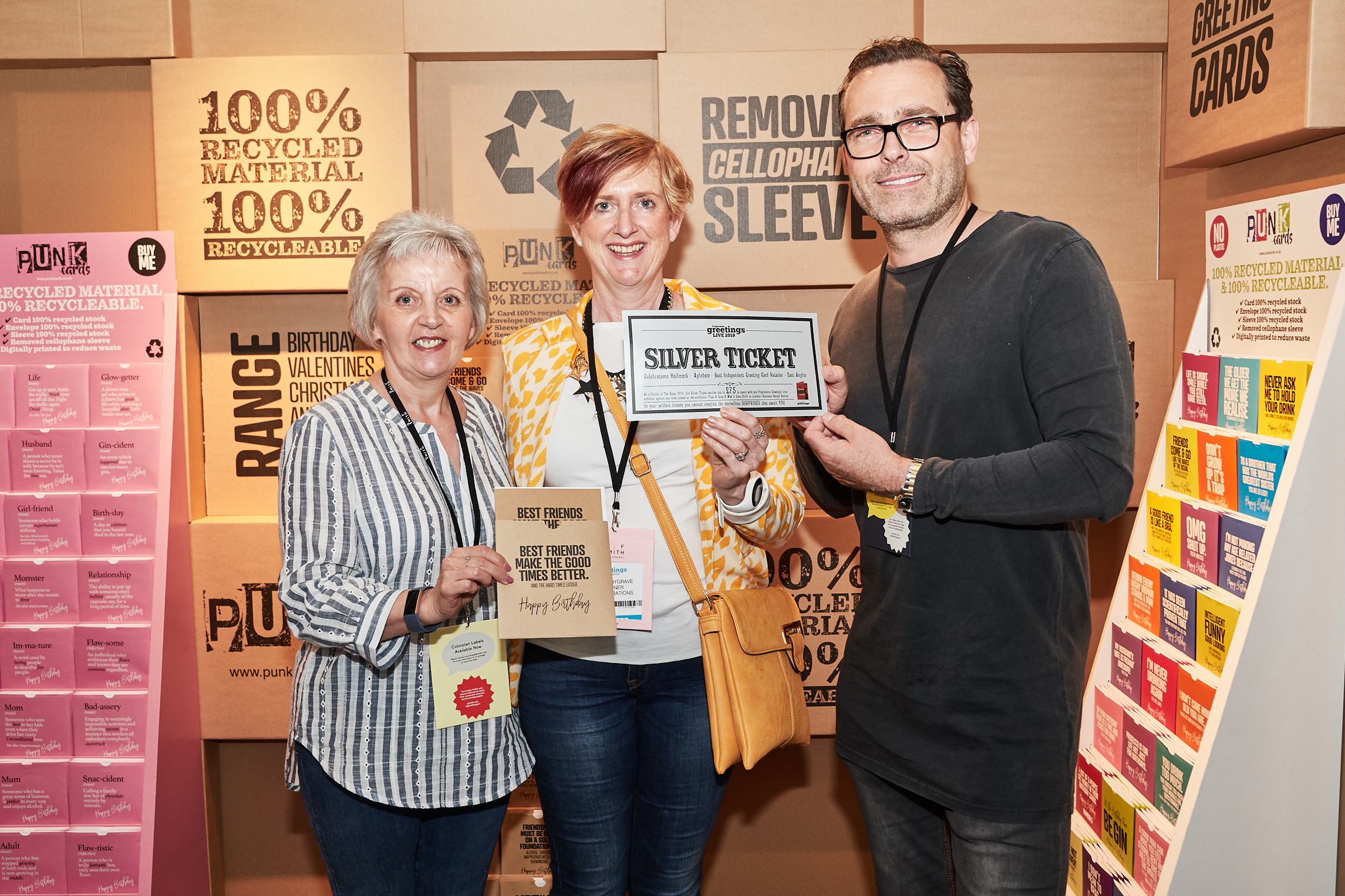 Above: Celebrations' Lynda Bygrave (centre) with colleague Mandy Baker on the Punk Cards' stand with owner David Nicholas, which made great stand about its environmental credentials.